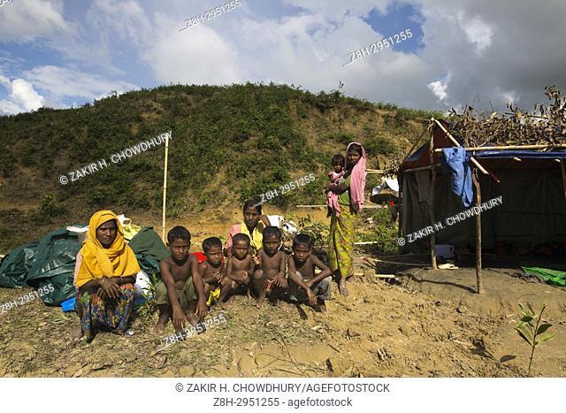 COX'S BAZAR, BANGLADESH - OCTOBER 19 : Newly arrived Rohingya people waits under open air Balukhali refugee camp in Cox's Bazar, Bangladesh on October 19, 2017