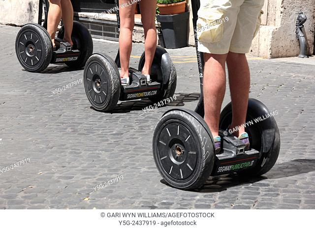 tourists riding segway transporters in Rome, Italy