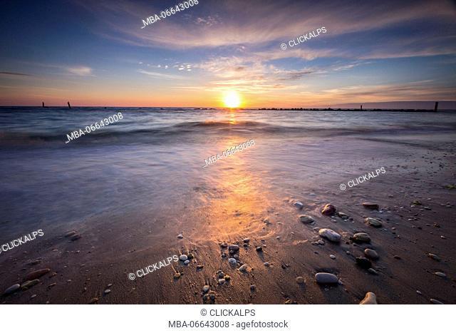 The lights of dawn are reflected on the sandy beach Porto Recanati Province of Macerata Conero Riviera Marche Italy Europe