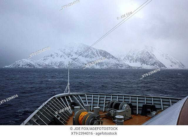 passenger ship sailing along the coast of the norwegian sea during winter norway europe