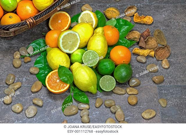 assortment with citrus fruits in a basket