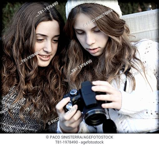 Young girls using camera