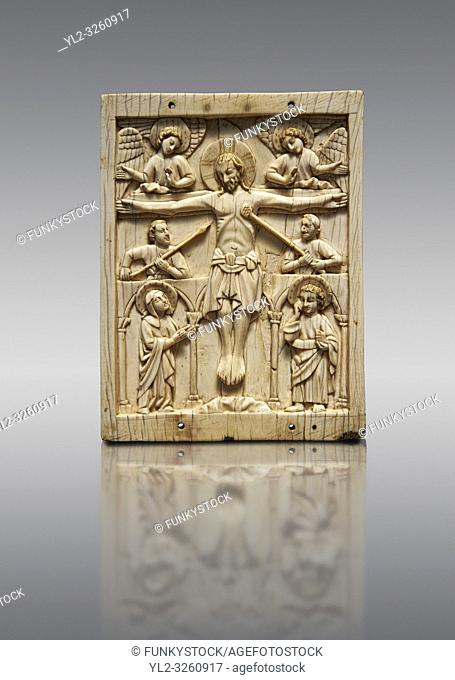 Medieval elephant ivory plaque with traces of paint made in Italy in the 13th or start of the 14th century. The crucifixion is a rare example of a Gothic piece...
