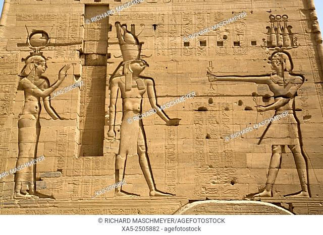 Reliefs of the Goddess Hathor (left) and the God Horus (center) with Neos Dionysos (right), Second Pylon, Temple of Isis, Island of Philae, Aswan, Egypt