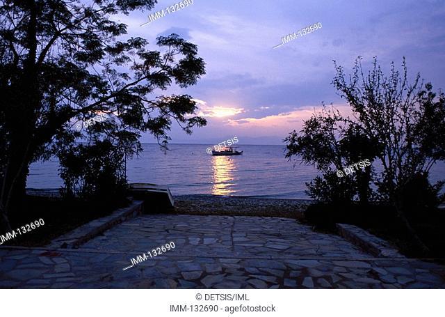 Evia Rovies village, sunset, fishing boat