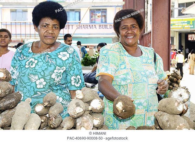Fiji, Viti Levu, Sigatoka, fijian women selling casava root at a local market