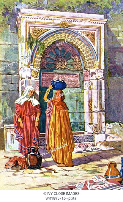 This 1902 illustration shows two women at a water fountain in Morocco. The fountain is designed in the style typically referred to as Arab