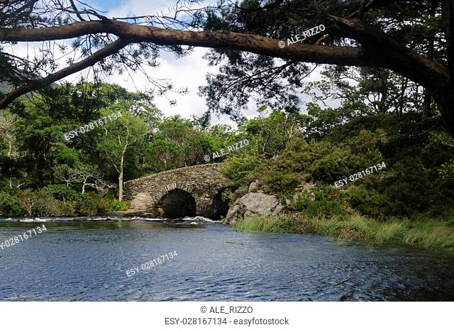Meeting of the water: a stone bridge between Lough Leane (Lower Lake) and Upper Lake in Killarney National Park, County Kerry, Ireland, Europe
