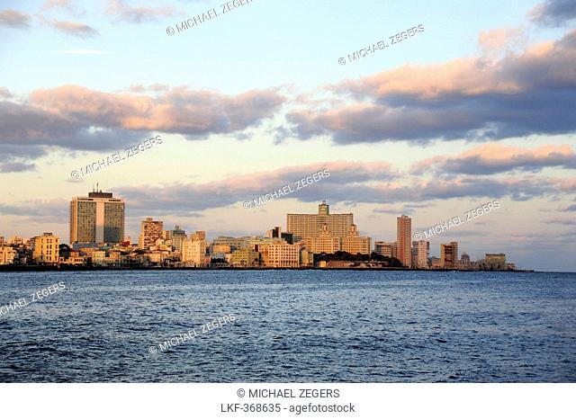 Sunrise at the Malecon, view towards Habana Vedado, Havana, Cuba, Greater Antilles, Gulf of Mexico, Caribbean, Central America, America