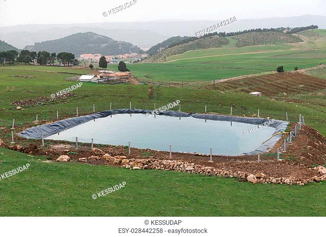 The manmade pool for agriculture by using plastic sheet to protect water leak out to the ground in Ifrane city, Morocco