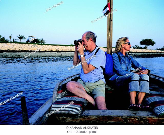 Western tourists on a sightseeing tour on the creek in Dubai, United Arab Emirates