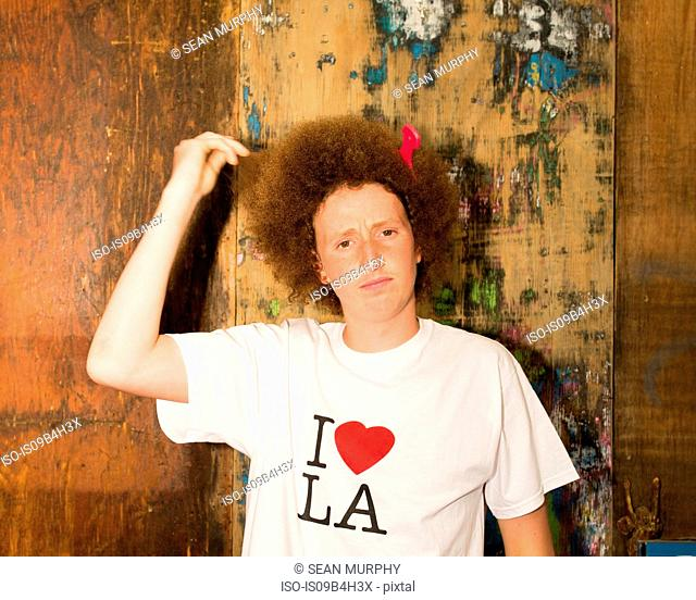 Portrait of teenage boy with red afro hair