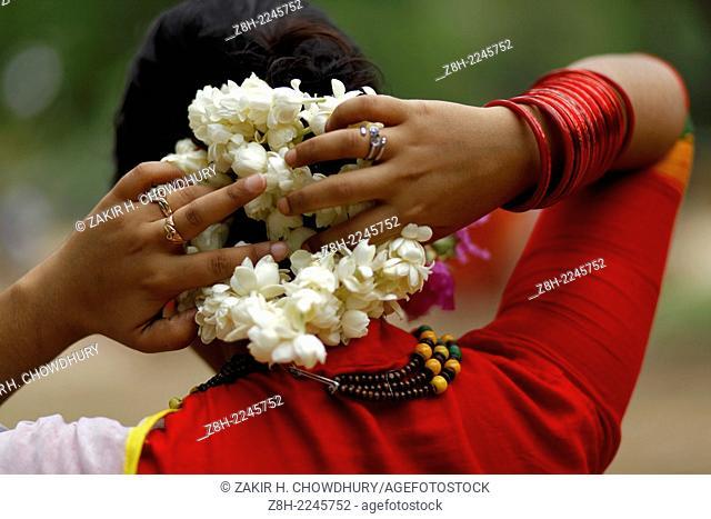 Woman with flowers on her hair, Dhaka, Bangladesh