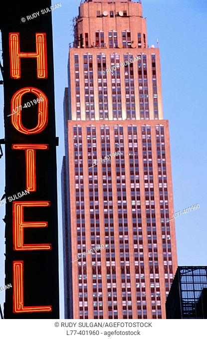 Empire State building and hotel sign, New York City. USA