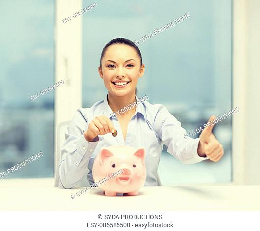 banking and finances concept - lovely woman with piggy bank and cash money showing thumbs up