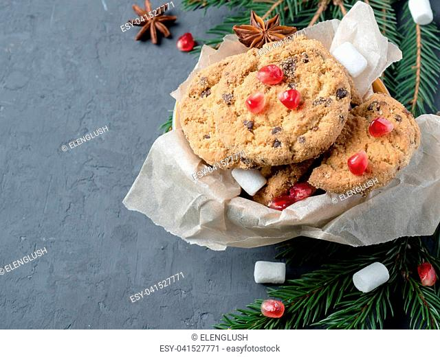 Christmas Plate of Cookies Chocolate Pomegranate Concrete Background Copy Space