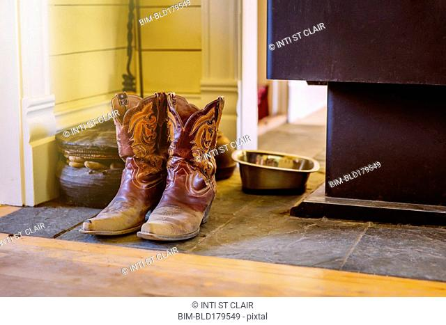 Dirty boots on stone tile
