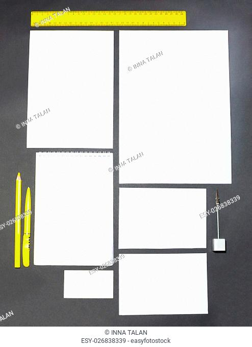 Mock-up business template with cards, papers, pen on gray background