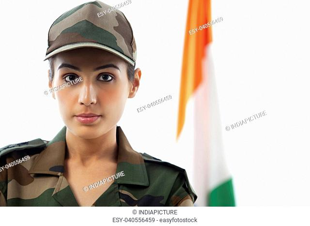 Close-up of female soldier in front of Indian flag
