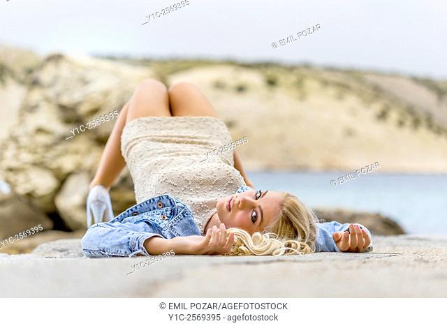 Top down lying on back attractive young woman