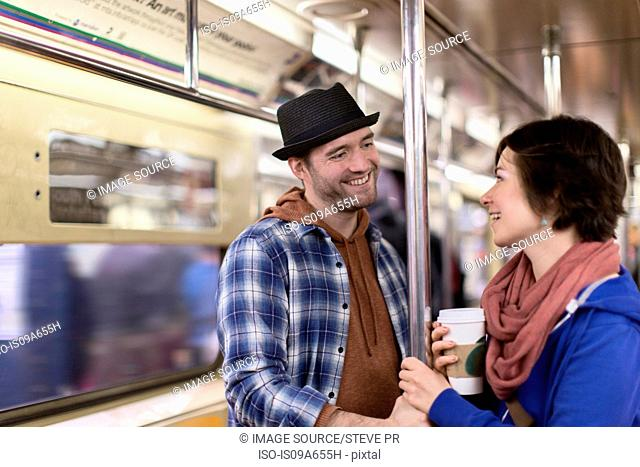 Couple talking on urban subway