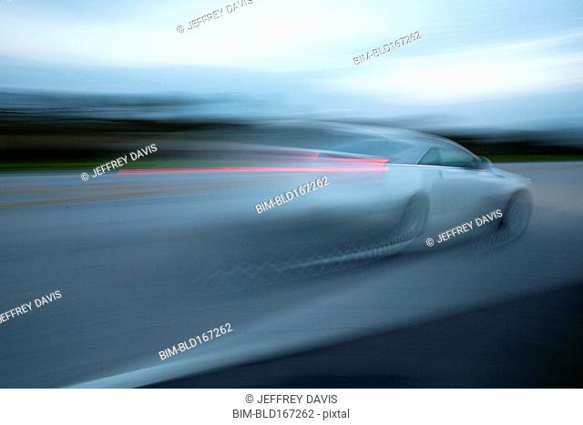 Blurred view of car driving on road