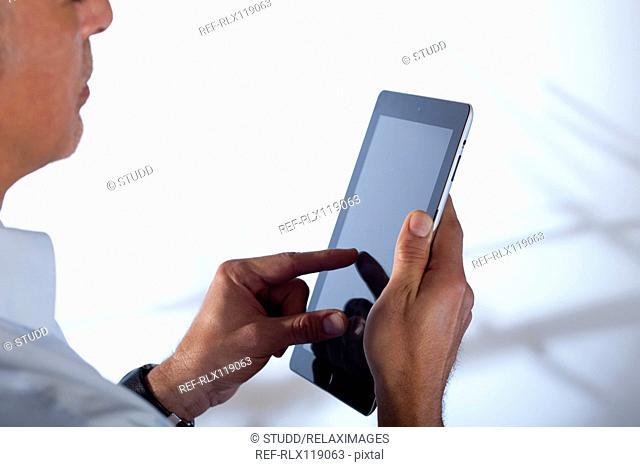 man showing Tablet PC iPad presentation close up