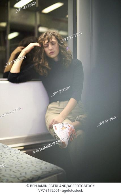 Woman in public transport in Berlin, Germany