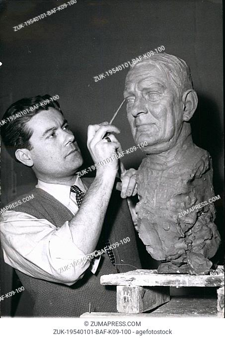 Jan. 01, 1954 - Ready for Musee Greevin M. Barbieri, the musee grevin sculpto, puts finishing touches to the head of M. Rene Coty, the president Elect ? M