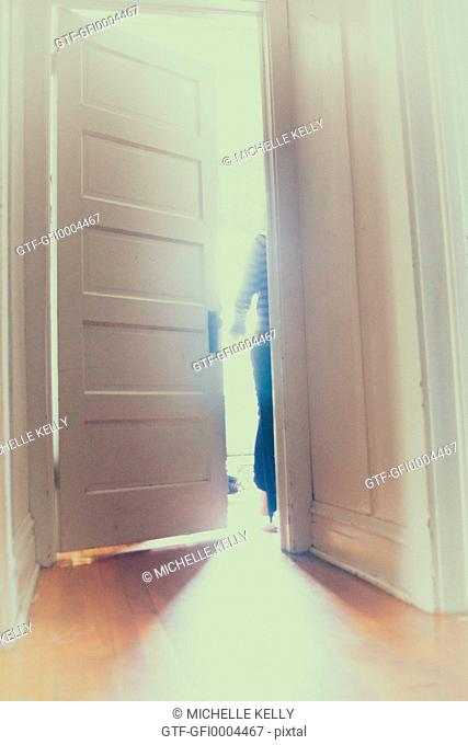Figure exiting through a door