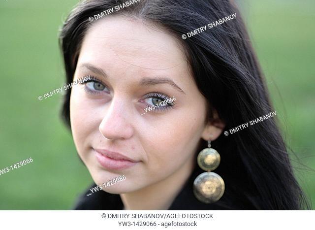 beautiful brunette outdoor portrait on grass