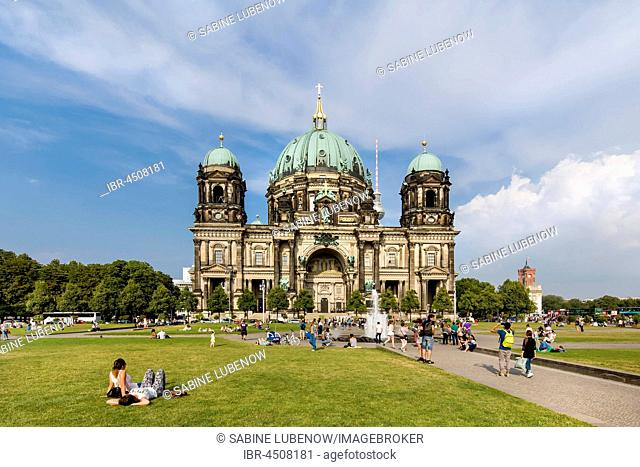 People sitting on lawn in front of the Berlin Cathedral, Museum Island, Berlin-Mitte, Berlin, Germany