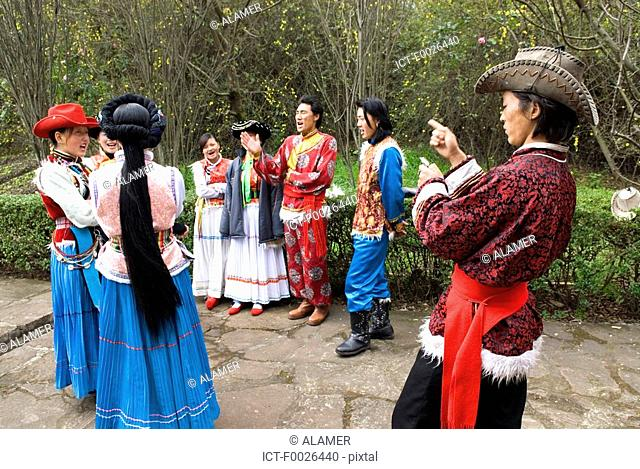 China, Yunnan, near Kunming, Yunnan Nationalities Village, traditional costumes of several chinese ethnic groups