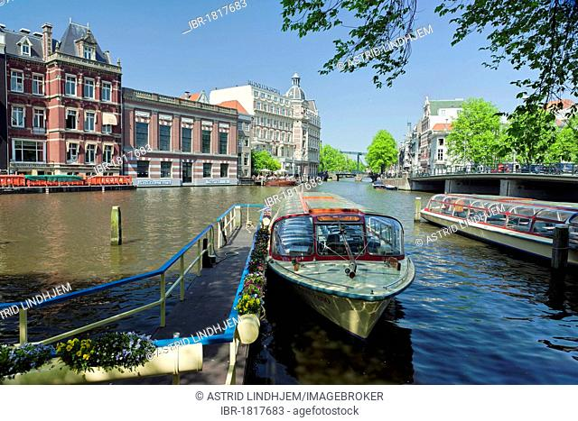 Excursion boats on a canal, Amsterdam, Netherlands, Europe