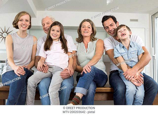 Smiling extended family side by side, portrait