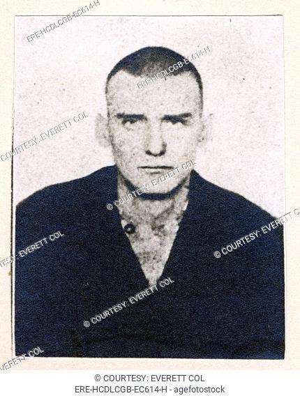 Wild West. Dave Merrill, mug shot, in prison garb, 1902