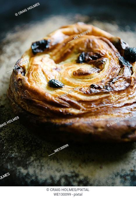 Pain aux raisins breakfast pastry. A breakfast food often eaten in France that is directly translated to raisin bread