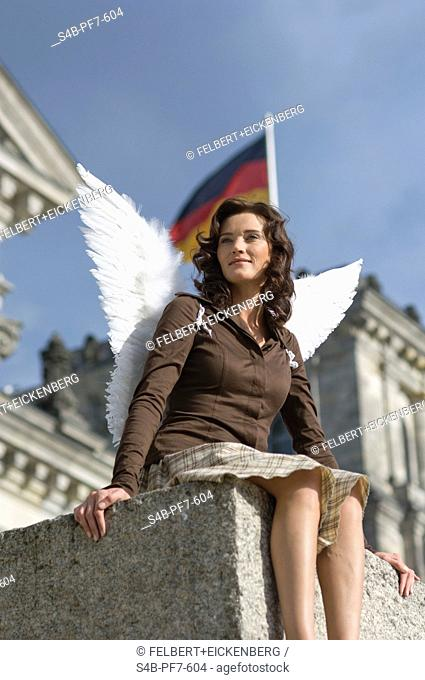 Woman with angel wings at the Reichstag, Berlin, Germany
