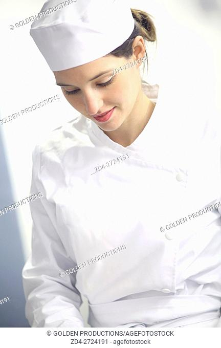 Portrait of smiling cook in restaurant kitchen