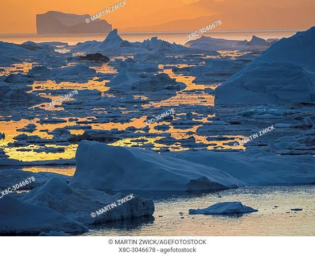 Ilulissat Icefjord also called kangia or Ilulissat Kangerlua, sunset over Disko Bay. The icefjord is listed as UNESCO world heritage