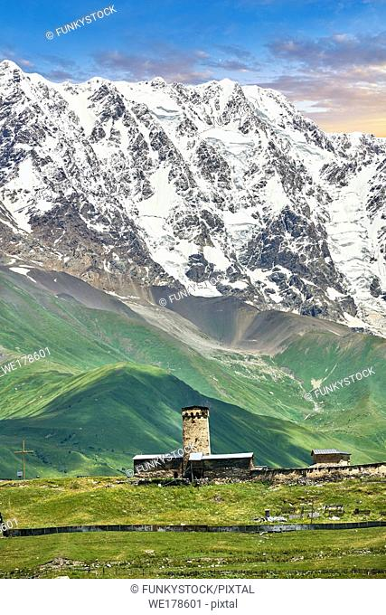 "The medieval Georgian Orthodox St George Church ""JGRag"" with mount Shkhara (5193m) behind, Ushguli, Upper Svaneti, Samegrelo-Zemo Svaneti, Mestia, Georgia"