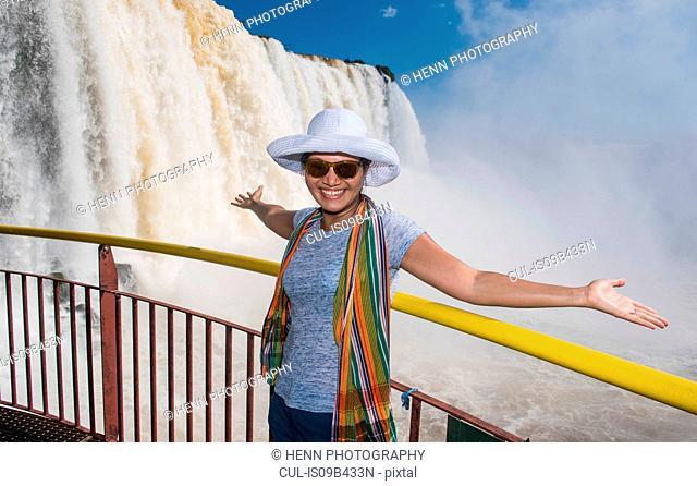 Woman admiring Iguazu falls, Parana, Brazil