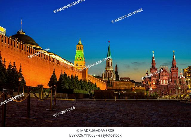 Illuminated Kremlin wall in Moscow, Russia at night with Historical Museum at the background. Sunset clear sky
