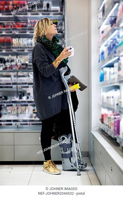 Woman with broken leg in shop