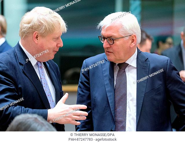 German Foreign Minister Frank-Walter Steinmeier (r) and UKForeign Minister Boris Johnson in conversation before a meeting of EUforeign ministers at the EU...