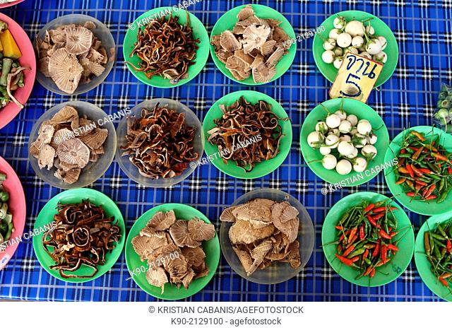 Fresh ingreedients for Thai food for sale on the market, one plate for five Bhat, Mae Hong Son, Thailand, Southeast Asia