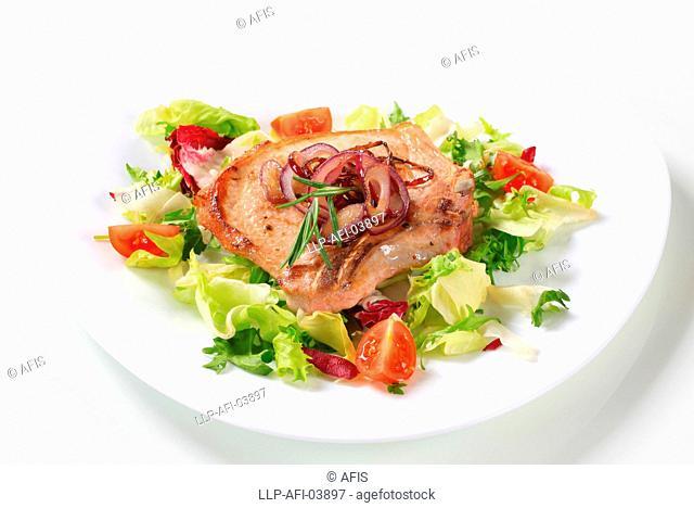 Pork chop with green salad