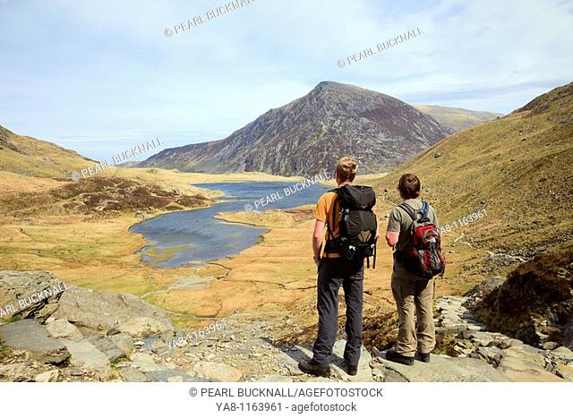 Cwm Idwal, Gwynedd, North Wales, UK, Europe  Walkers by Llyn Idwal in the mountains of Snowdonia National Park