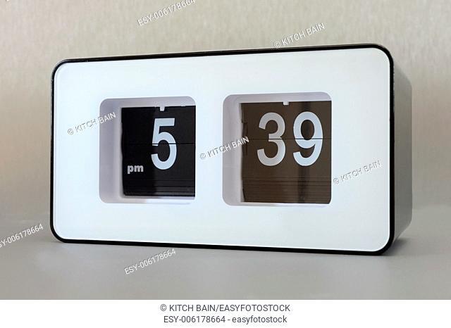 A close up shot of a flip clock
