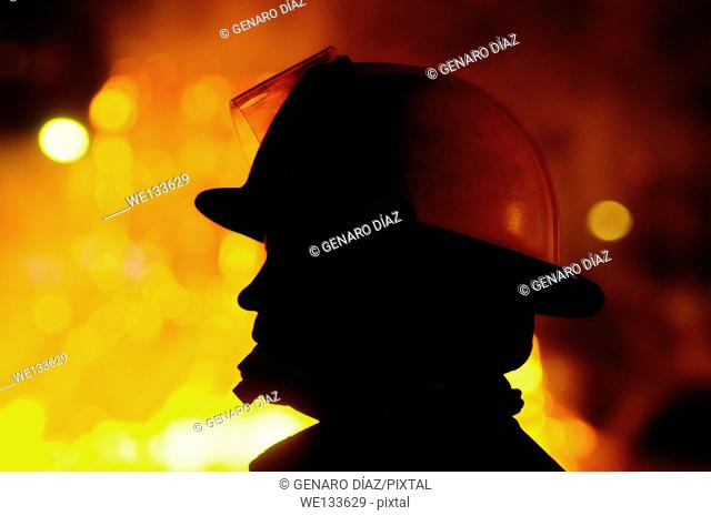 firefighter take care bonfires on the night of Saint John in Corunna, Spain